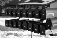 Brevlådor i snö royaltyfri bild