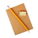 Brevpapper - anteckningsbok, radergummi och blyertspenna fotografering för bildbyråer