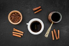 Brew coffee in turkish coffee pot. Black background top view copyspace Royalty Free Stock Photography