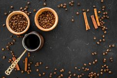 Brew coffee in turkish coffee pot. Black background top view copyspace Royalty Free Stock Image