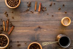 Brew coffee in turkish coffee pot. Wooden background top view copyspace Royalty Free Stock Image