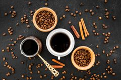Brew coffee in turkish coffee pot. Black background top view Royalty Free Stock Photography