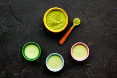 Brew matcha tea. Bowl with powder and cups with beverage on black background top view copy space. Brew matcha tea. Bowl with powder and cups with beverage on Stock Photography