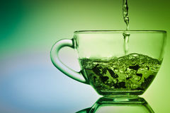Brew a tea in small a cup Royalty Free Stock Photo