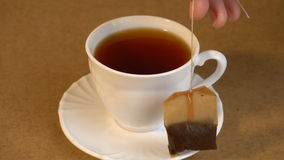 Brew teabag and lemon in Cup of tea stock video footage