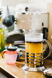 Brewed black tea in the teapot. Stands on the kitchen table Royalty Free Stock Image
