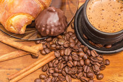 Brewed coffee, coffee beans, cinnamon sticks, chocolate truffle Stock Images