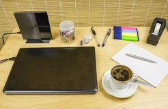 Brewed coffee in a cup on a desk. Royalty Free Stock Photography