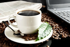 Brewed coffee with laptop,newspaper,coffee leaf at breakfast Royalty Free Stock Image