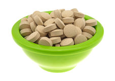 Brewer's yeast nutritional supplement in a green bowl Stock Images