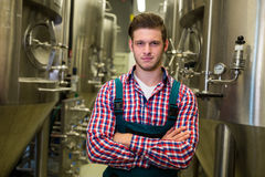 Brewer with arms crossed at brewery Stock Photography