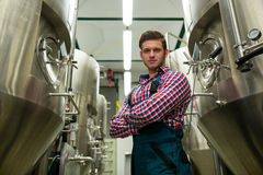 Brewer with arms crossed at brewery Royalty Free Stock Photography