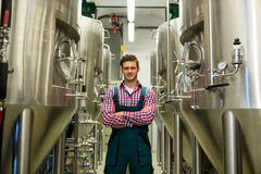Brewer with arms crossed at brewery Royalty Free Stock Photos