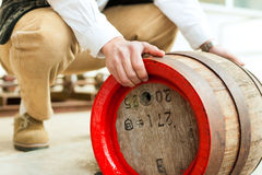 Brewer with beer barrel in brewery Stock Photos