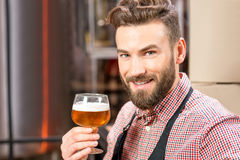 Brewer with beer Stock Images