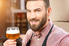 Brewer with beer Royalty Free Stock Photography