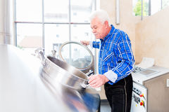 Brewer in brewhouse Royalty Free Stock Photography