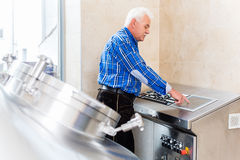 Brewer in brewhouse in beer brewery Stock Photo