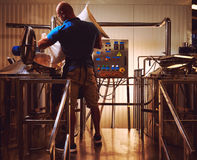 Brewer in brewhouse Stock Photography