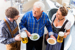 Brewer and couple in beer brewery Royalty Free Stock Photography
