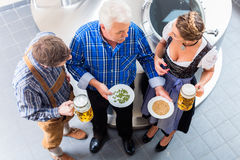 Brewer and couple in beer brewery tour Stock Images