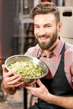 Brewer with hops Royalty Free Stock Image
