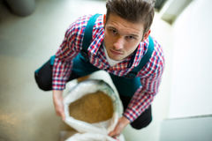 Brewer with sack of grains Royalty Free Stock Photo