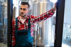 Brewer standing at brewery. Thoughtful brewer standing at brewery Stock Photos