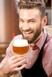 Brewer tasting beer Stock Image