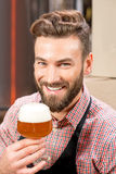 Brewer tasting beer Royalty Free Stock Photo