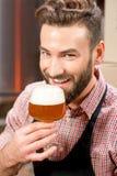 Brewer tasting beer Royalty Free Stock Image