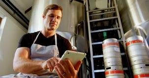 Brewer using digital tablet 4k. Brewer using digital tablet at brewery factory 4k stock video