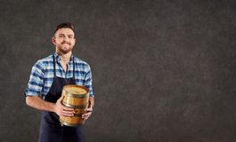 The brewer, the winemaker the munchina with a barrel in his hand. S Stock Image