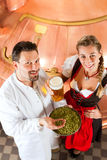 Brewer and woman with beer glass in brewery Stock Photos