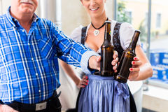 Brewer and woman toasting in beer brewery Royalty Free Stock Photography