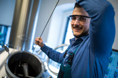 Brewer working at brewery stock image