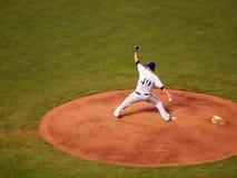 Brewers Pitcher Yovani Gallardo steps forward on mound to throw Stock Image