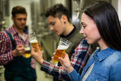 Brewers testing beer at brewery factory Royalty Free Stock Photos