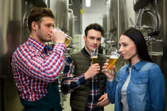 Brewers testing beer at brewery factory Stock Photo