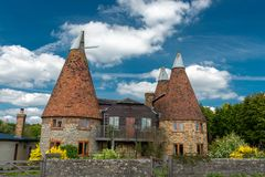 Brewery barn buildings in English countryside royalty free stock photography