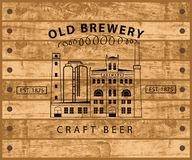 Brewery building against wooden planks Stock Images