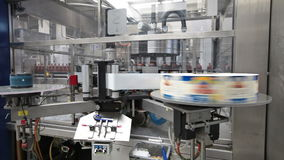 Brewery. The food industry. Conveyor line, machine for pasting labels for beer bottles