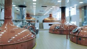 Brewery hall with copper tanks in it. 4K stock video footage