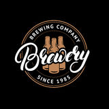 Brewery hand drawn lettering logo, label, badge, emblem with beer bottles. Stock Photo