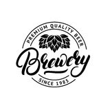 Brewery hand drawn lettering logo, label, badge, emblem with hop. Royalty Free Stock Photo
