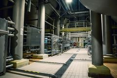 Brewery manufacturing factory. Stainless steel vats or tanks with pipes, brewing equipment, modern alcohol production technology. Toned royalty free stock images