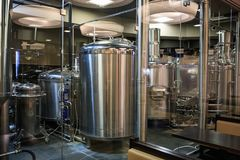 Brewery manufacturing factory. Stainless steel vats or tanks with pipes, small brewing equipment, modern alcohol production stock photography