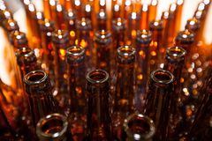 The necks of empty beer bottles, which will pour beer, top view. Brewery. The necks of empty beer bottles, which will pour beer, top view stock photos