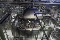 Brewery production line, steel tanks or vats for beer fermentation and manufacturing, pipelines and modern machinery. Equipment Royalty Free Stock Images