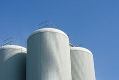 Brewery tanks blue sky big containers beer production industry Royalty Free Stock Image